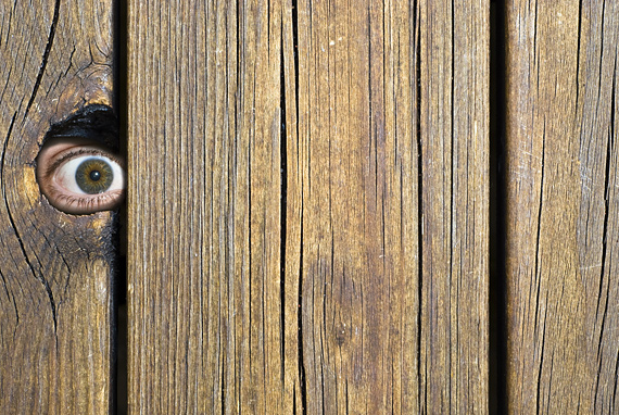Image code: 1021504 - Eye peeking through hole in fence © thomland at Crestock.com